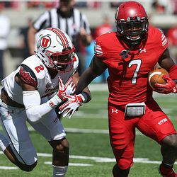 Utah's Devonta'e Henry-Cole  (7) runs with the ball before being tackled by (2) Philip Afia during the annual Red & White Spring Game at Rice-Eccles Stadium in Salt Lake City on Saturday, April 15, 2017.