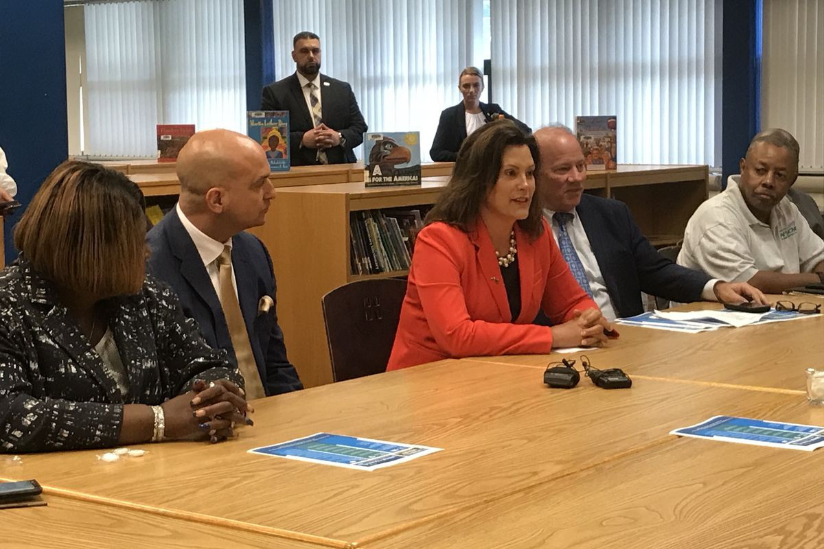 Michigan Gov. Gretchen Whitmer is flanked by Detroit Superintendent Nikolai Vitti, left, and Detroit Mayor Mike Duggan, right, as she makes the case for her K-12 budget recommendations during an event Tuesday at Charles H. Wright Academy of Arts and Sciences.