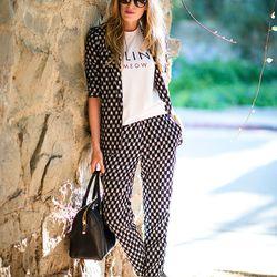 "Kimberly of <a href=""http://www.eatsleepwear.com""target=""_blank"">Eat Sleep Wear</a> is wearing an H&M pant suit, a <a href=""http://www.net-a-porter.com/product/390336?cm_mmc=LinkshareUS-_-QFGLnEolOWg-_-ProductSearch-_-us-_-Tops-_-Féline&gclid=CNK05qWnvrc"