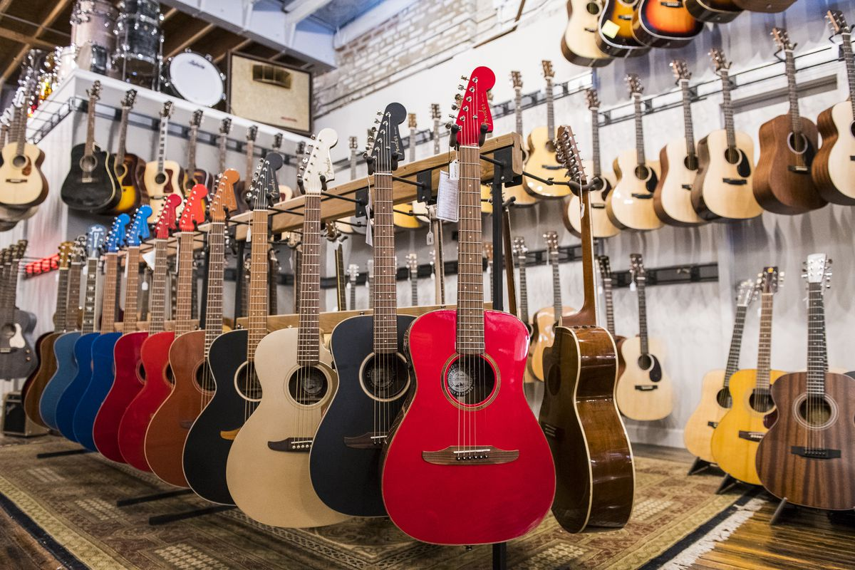 Hundreds of guitars hang from shelves and racks at Rock N Roll Vintage Guitar Shop in Ravenswood.   Tyler LaRiviere/Sun-Times
