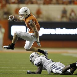 Wide receiver Jaxon Shipley #8 of the Texas Longhorns hurdles defensive back Joe Sampson #5 of the BYU Cougars in the fourth quarter on September 10, 2011 at Darrell K. Royal-Texas Memorial Stadium in Austin, Texas.  Texas defeated BYU 17-16.  (Photo by Erich Schlegel/Getty Images)