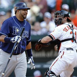 Tampa Bay Rays' Jose Molina, left, reacts as he walks off the field after striking out swinging in the 12th inning of a baseball game against the Baltimore Orioles in Baltimore, Thursday, Sept. 13, 2012. Baltimore won 3-2 in 14 innings.