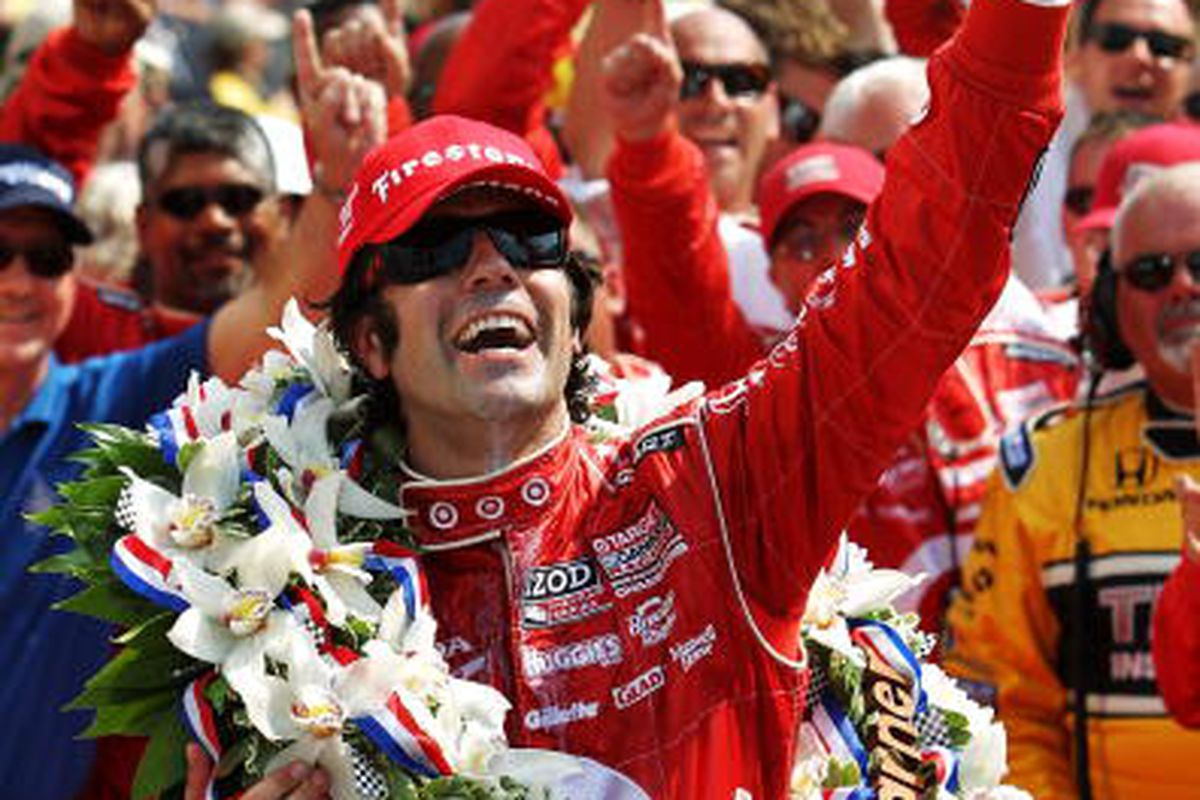 Dario Franchitti holds up the ceremonial winner's milk over in victory lane in celebration of winning the IZOD IndyCar Series 94th running of the Indianapolis 500. (Photo by Nick Laham/Getty Images)