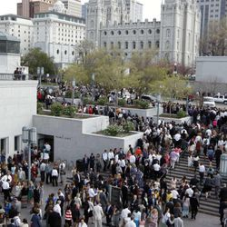 FILE - People gather outside The LDS Conference Building after a General Conference session in Salt Lake City Sunday, April 5, 2015.