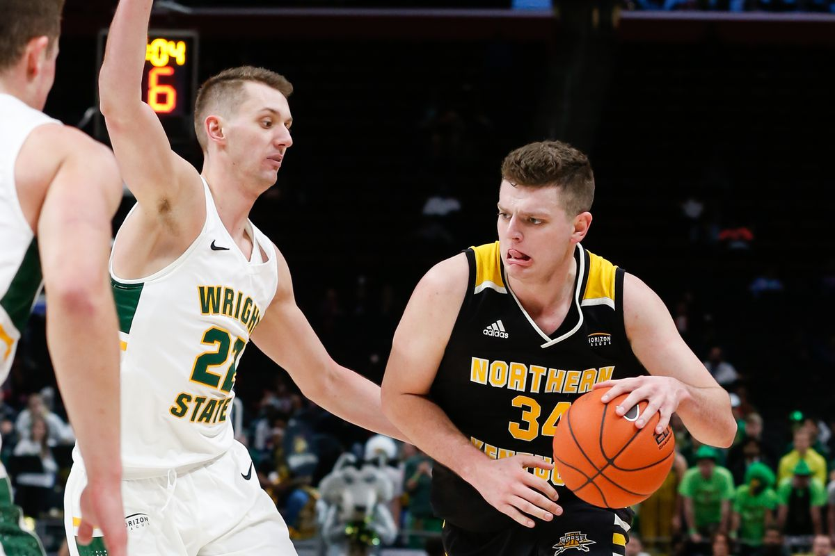 Northern Kentucky Norse forward Drew McDonald drives to the basket against Wright State Raiders center Parker Ernsthausen during the Horizon League Conference tournament championship game between the Wright State Raiders and the Northern Kentucky Norse on March 12, 2019 at Little Caesars Arena in Detroit. Michigan.