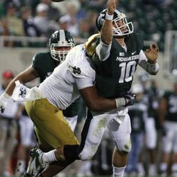 Michigan State quarterback Andrew Maxwell (10) fumbles the ball as he is hit by Notre Dame's T.J. Jones during the fourth quarter of an NCAA college football game, Saturday, Sept. 15, 2012, in East Lansing, Mich. Michigan State recovered the fumble. Notre Dame won 20-3.