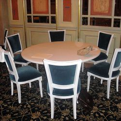 The new table and chair sets are deep blue against white.