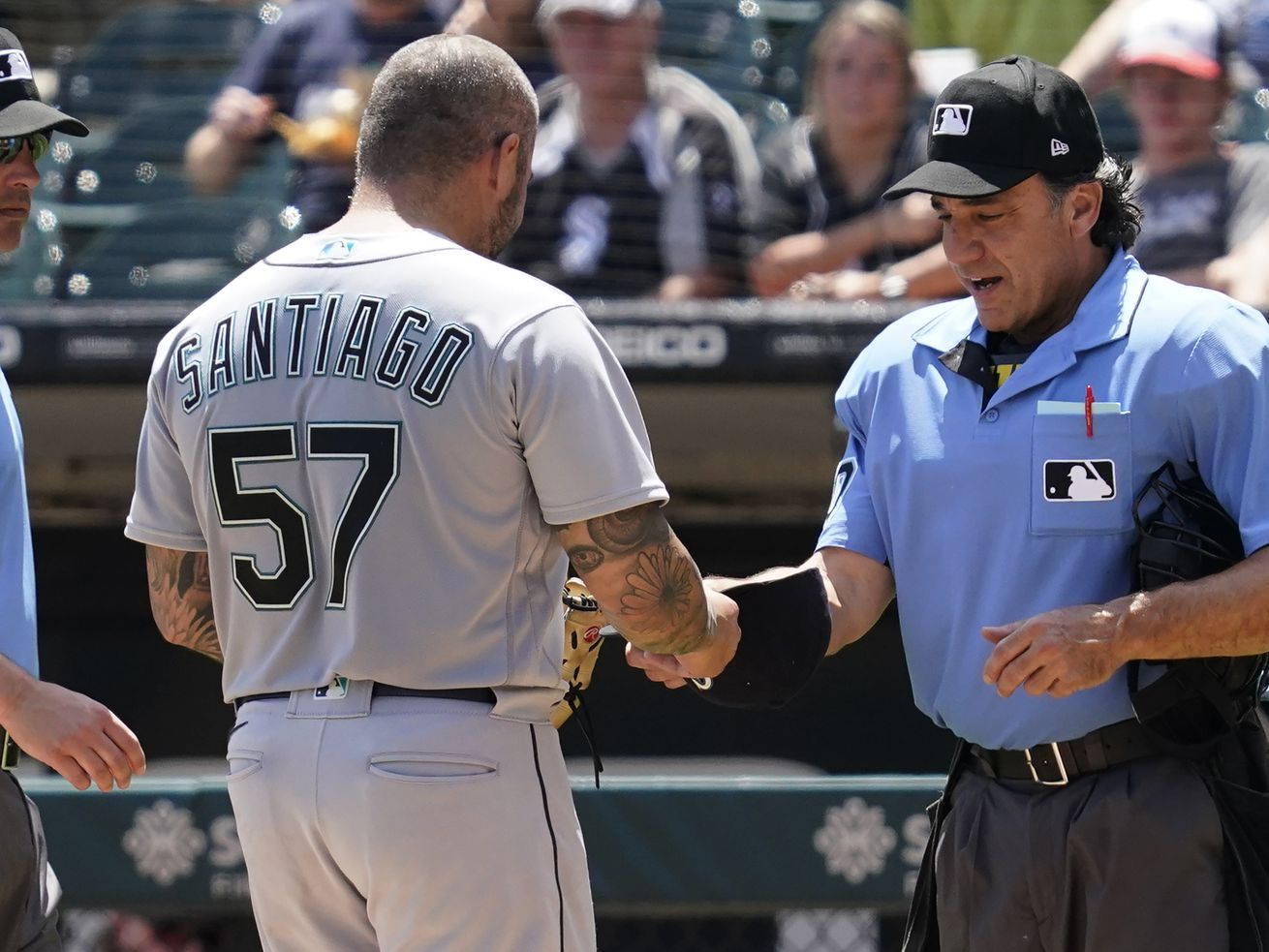 Umpire Phil Cuzzi talks with Seattle Mariners relief pitcher Hector Santiago Sunday at Guaranteed Rate Field. Cuzzi ejected Santiago.