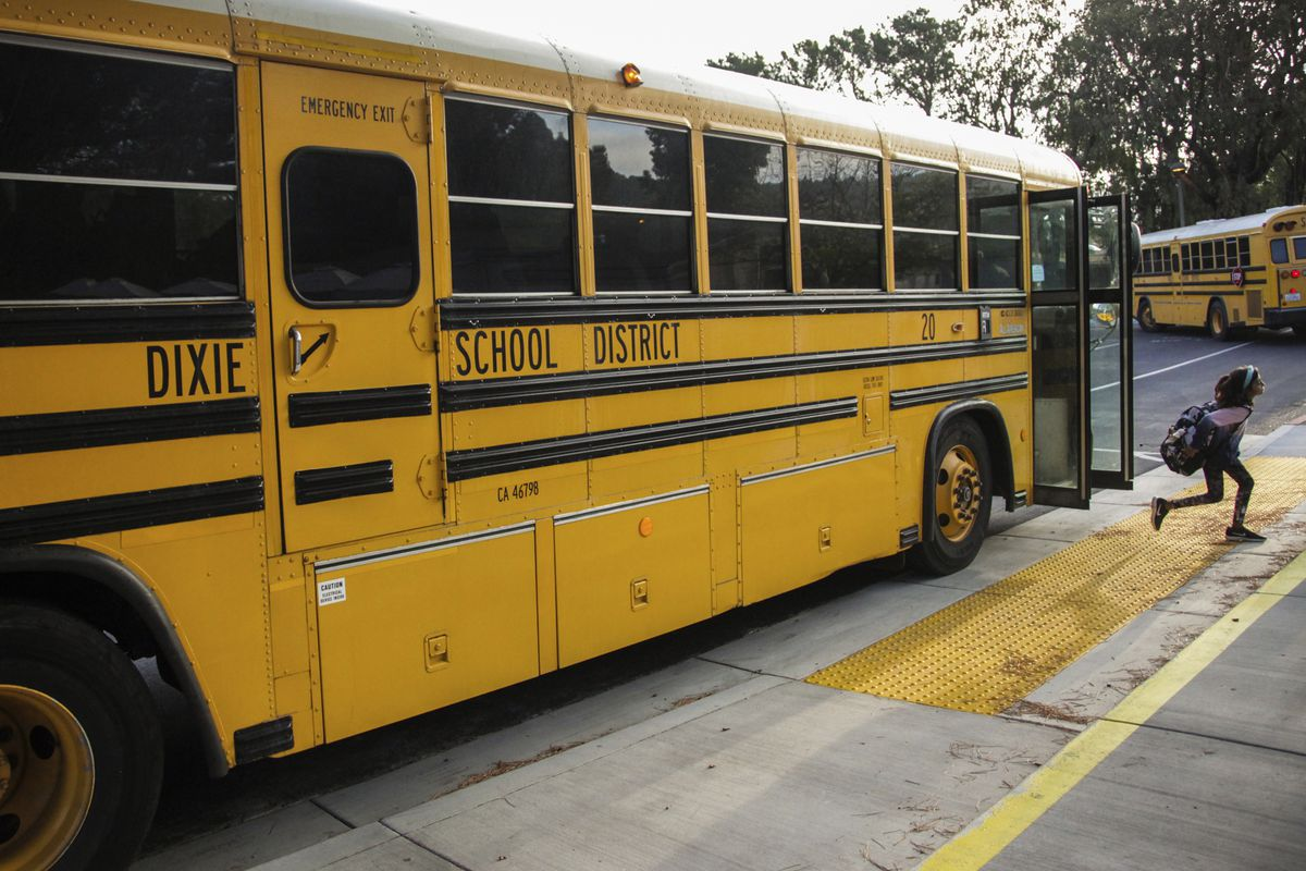 In this Oct. 18, 2018 file photo, a student hops off the school bus at Dixie Elementary School in San Rafael, Calif. The beginning of this new school year is a fresh start and a fresh reminder that the job of effective oversight of public education doesn'