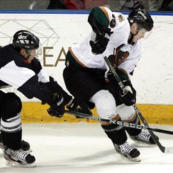Channing Boe, of Las Vegas, left, and Gaelan Patterson of Utah battle as the Utah Grizzlies face the Las Vegas Wranglers in ECHL hockey at the Maverik Center in West Valley City, Monday, April 2, 2012.