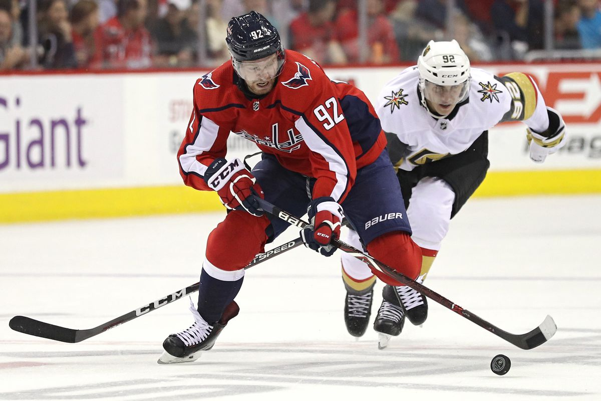 4082fc6da7b Evgeny Kuznetsov  92 of the Washington Capitals skates past Tomas Nosek  92  of the Vegas Golden Knights Photo by Patrick Smith Getty Images