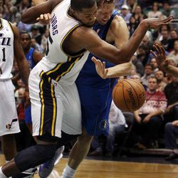 Derrick Favors of the Utah Jazz, left, and Dirk Nowitzki of the Dallas Mavericks fight for a loose ball during NBA basketball in Salt Lake City, Monday, Jan. 7, 2013. Favors was called for a foul.