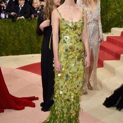 Mia Goth wears a Miu Miu dress.