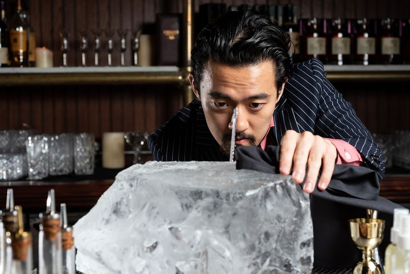 Bar director Kevin Lee cutting ice at The Wolves