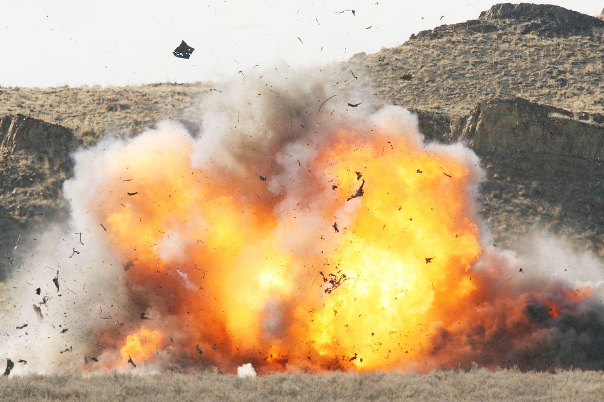 Officials use explosives to blow up several vehicles during an FBI training class at the Utah Test and Training Range in Tooele County's west desert on Feb. 14, 2006. Rep. Chris Stewart, R-Utah, has introduced a bill to rename the Utah Test and Training Range in honor of former Utah Rep. Rob Bishop.