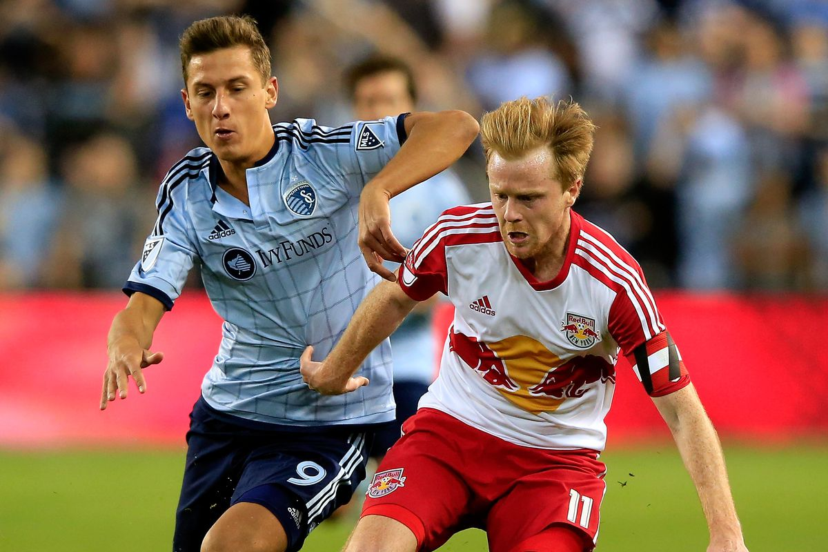 Dax McCarty defending the ball against Sporting KC