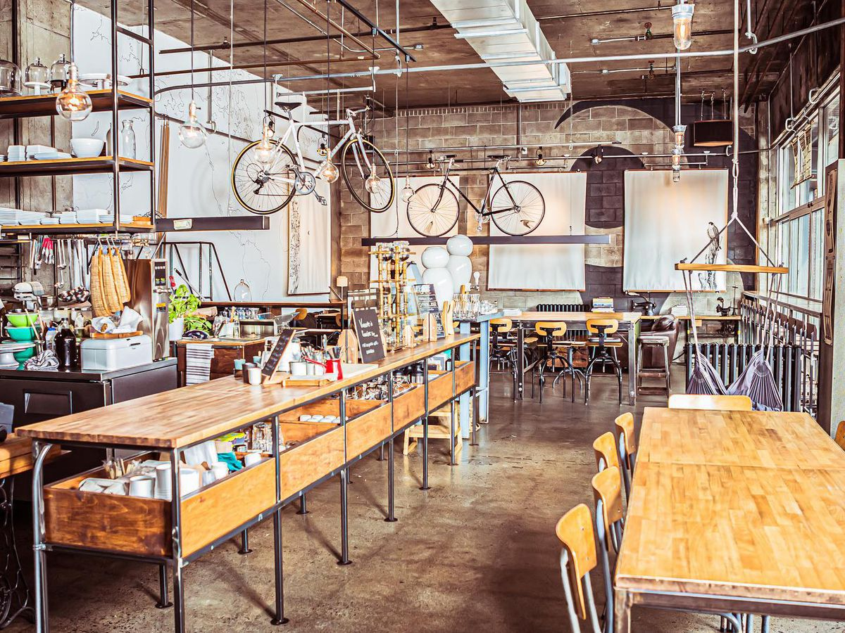inside of cafe with suspended bicycles