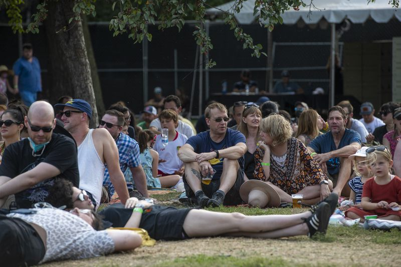 Festival-goers sit in the grass and listen as Waxahatchee performs on the Green Stage at Pitchfork music festival at Union Park, Saturday, Sept. 11, 2021.