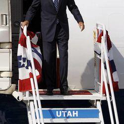 Mitt Romney arrives in Salt Lake City, Tuesday, Sept. 18, 2012.