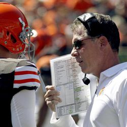 Cleveland Browns head coach Pat Shurmur, right, talks with quarterback Brandon Weeden (3) in the first half of an NFL football game against the Cincinnati Bengals, Sunday, Sept. 16, 2012, in Cincinnati.