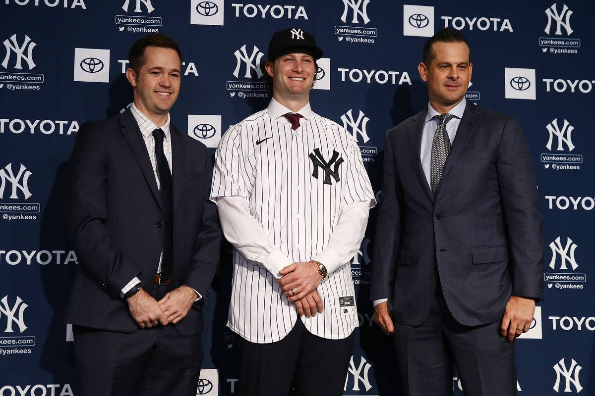 New York Yankee Pitching Coach, Matt Blake, Gerrit Cole, New York Yankee Manager, Aaron Boone of the New York Yankees pose for a photo at Yankee Stadium during a press conference at Yankee Stadium on December 18, 2019 in New York City.