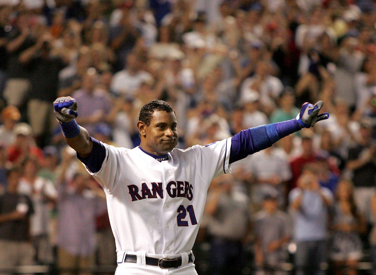 Texas Rangers' Sammy Sosa acknowledges the fans after hittin