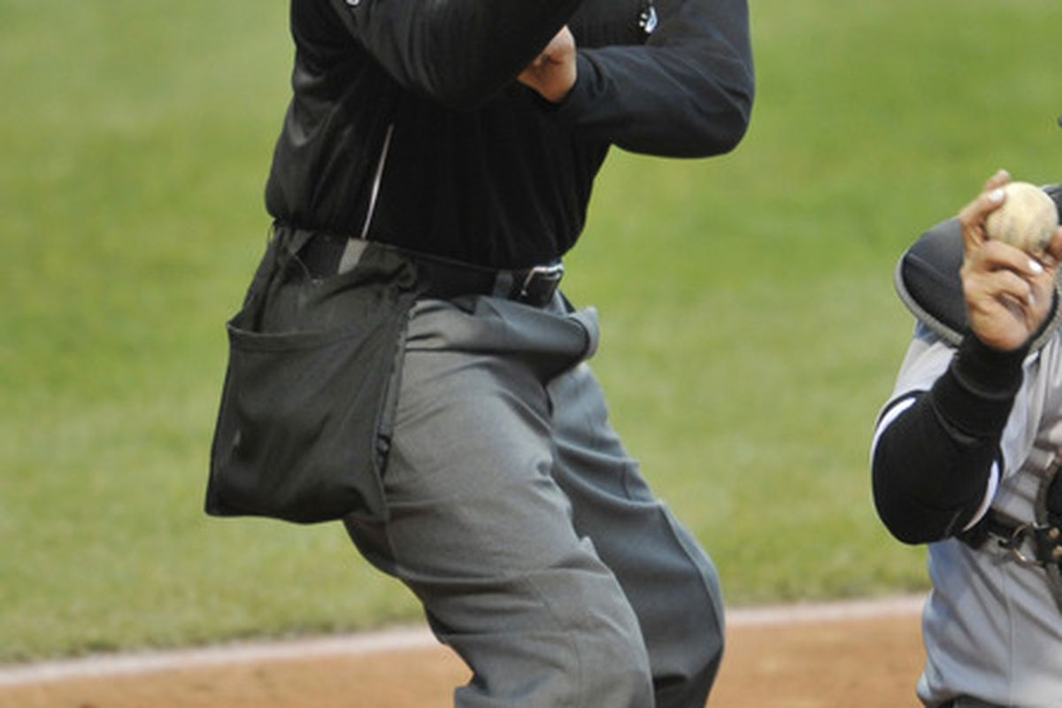 Apr 9, 2012; Cleveland, OH, USA; Home plate umpire Vic Carapazza (85) calls a strike in the third inning of a game between the Chicago White Sox and the Cleveland Indians at Progressive Field. Mandatory Credit: David Richard-US PRESSWIRE