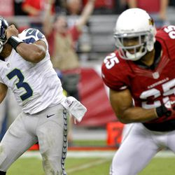 Seattle Seahawks quarterback Russell Wilson (3) reacts to a missed pass as Arizona Cardinals free safety Kerry Rhodes (25) defends as time expires during the second half of an NFL football game on Sunday, Sept. 9, 2012, in Glendale, Ariz. The Cardinals won 20-16.