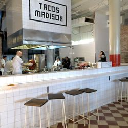 Tacos Madison is the name of the taqueria inside Cafe El Presidente. Behind the bar, Jason DeBriere packs meat for al pastor tacos onto a rotating trompo, a process he compares to making a sculpture. Owner Dario Wolos says he offered the job to DeBriere a