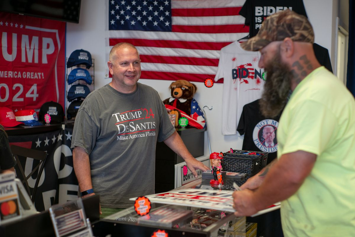 Mike Domanico talks to a customer who purchased a Trump yard sign at The Trump Store in Bensalem, Penn., on Thursday, Sep. 9, 2021.