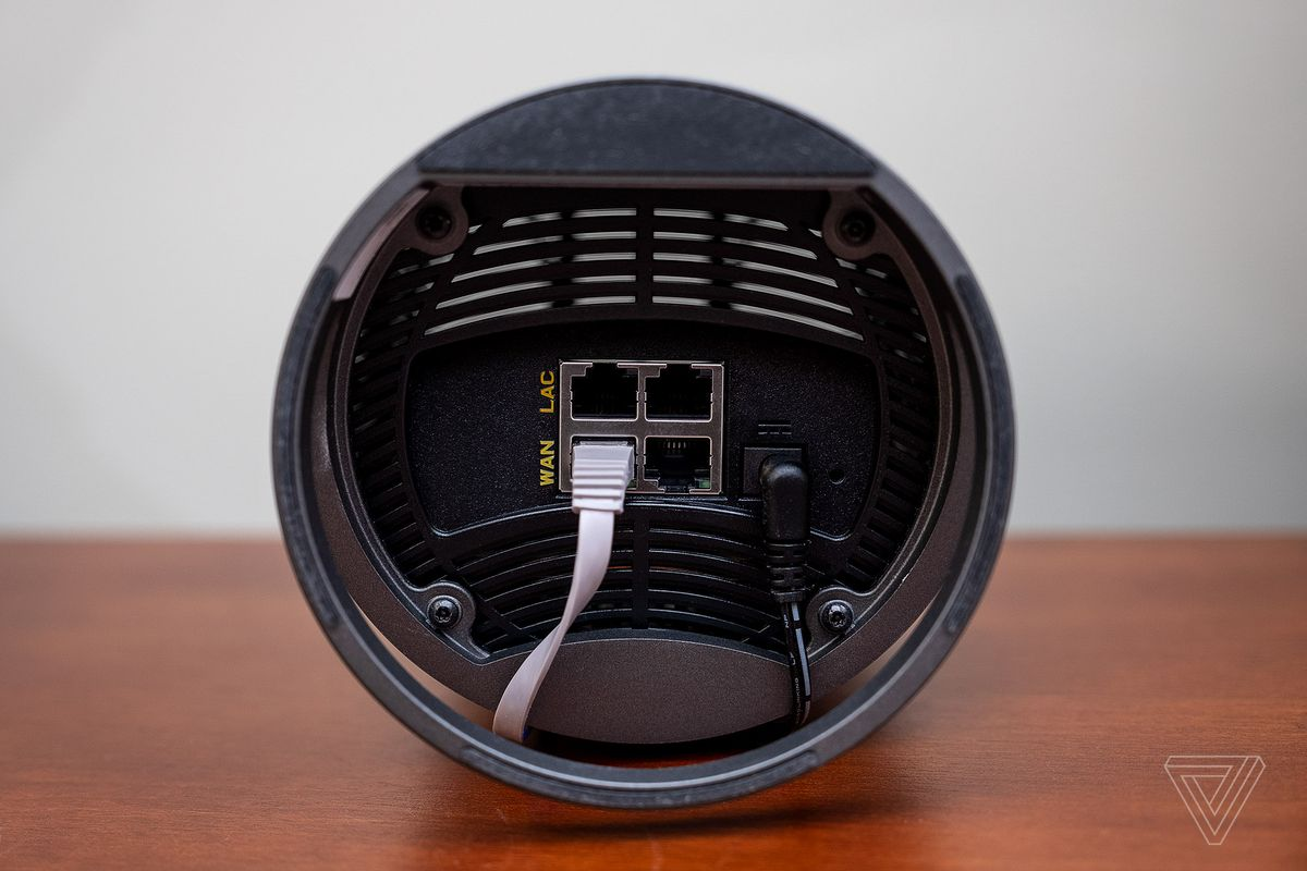 The bottom of an Arris Surfboard Max Pro shows its four Ethernet ports.