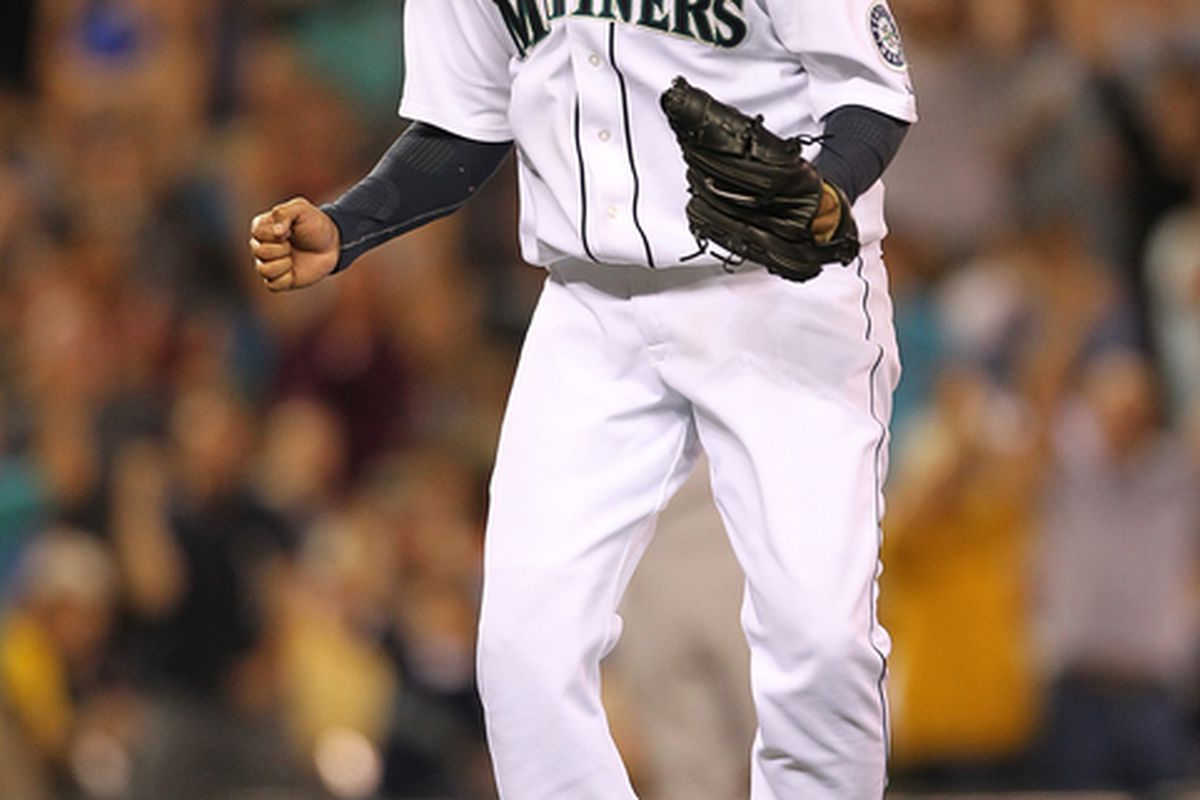 SEATTLE - JULY 10:  Starting pitcher Felix Hernandez #34 of the Seattle Mariners jumps for joy after defeating the New York Yankees 4-1 at Safeco Field on July 10 2010 in Seattle Washington.  (Photo by Otto Greule Jr/Getty Images)