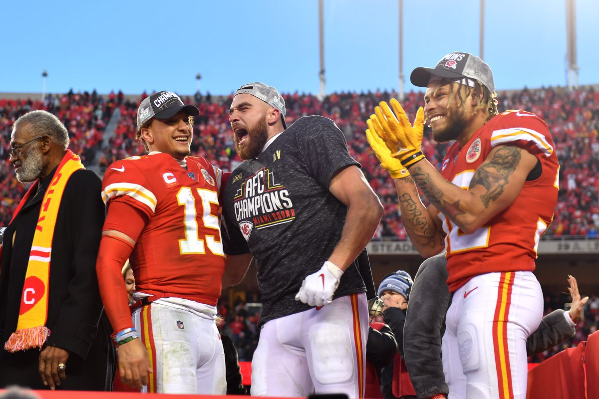 Patrick Mahomes, Travis Kelce and Tyrann Mathieu of the Kansas City Chiefs celebrate after defeating the Tennessee Titans in the AFC Championship Game at Arrowhead Stadium on January 19, 2020 in Kansas City, Missouri.