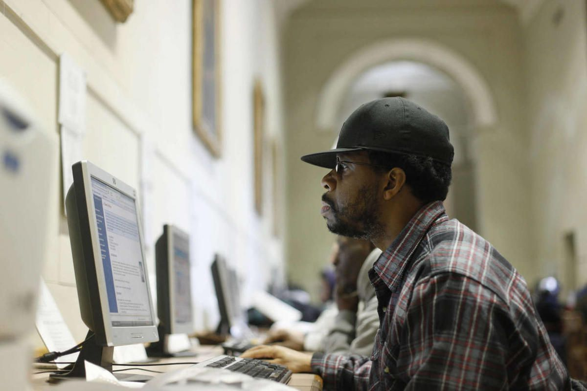 James Dash Jr., who is unemployed, uses a computer to look for work at the central branch of the Free Library of Philadelphia in Philadelphia, Wednesday, Dec. 30, 2009.
