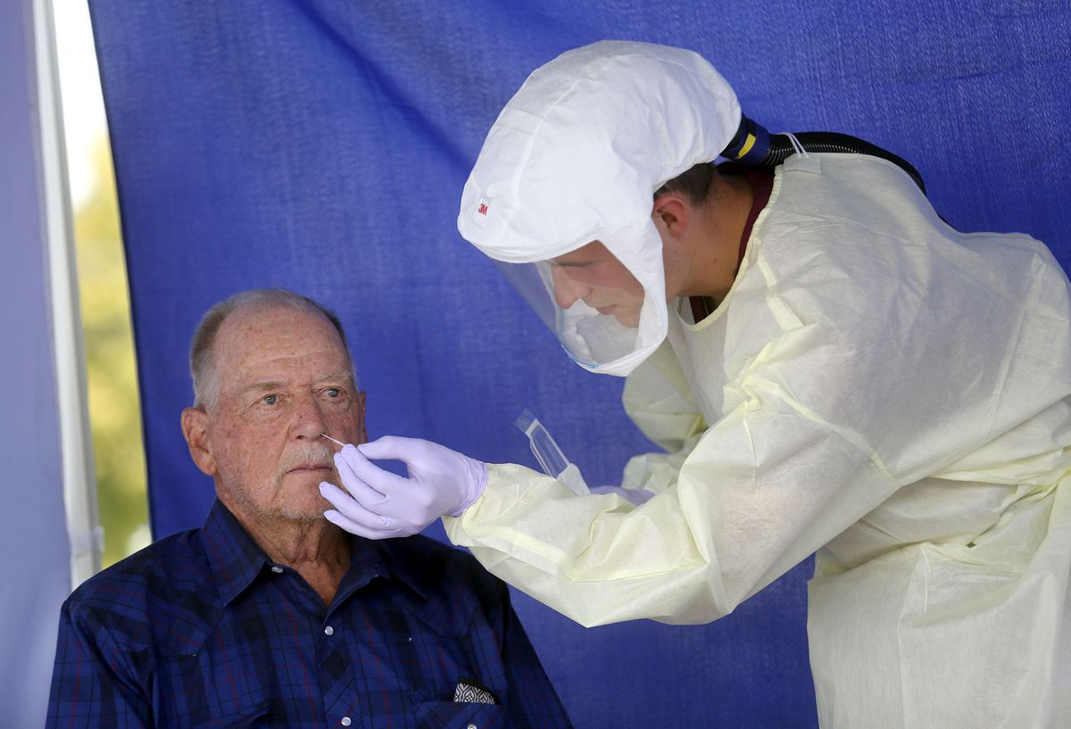 Jim Ford gets tested for COVID-19 by phlebotomist Ethan Laudie at an Intermountain Healthcare mobile testing site outside of Orem Community Hospital in Orem on Tuesday, Oct. 6, 2020.