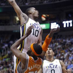 Utah Jazz guard Alec Burks (10) goes hard to the hoop over Phoenix Suns forward Hakim Warrick (21) missing the dunk as the Utah Jazz and the Phoenix Suns play Tuesday, April 24, 2012 in Energy Solutions arena.