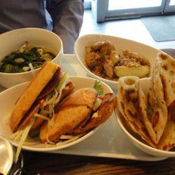 Clockwise from top: Duck dumpling soup, fingerling potatoes, chive pancakes, duck sandwich.