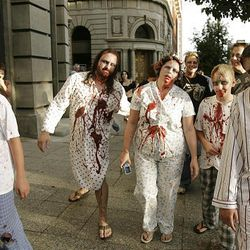 Zombie Walk participants stroll the streets of Salt Lake City on Sunday.