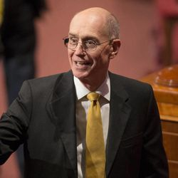 President Henry B Eyring waves as he leave the stand following the Sunday afternoon session of the 183rd Semiannual General Conference for the Church of Jesus Christ of Latter-day Saints Sunday, Oct. 6, 2013 inside the Conference Center.
