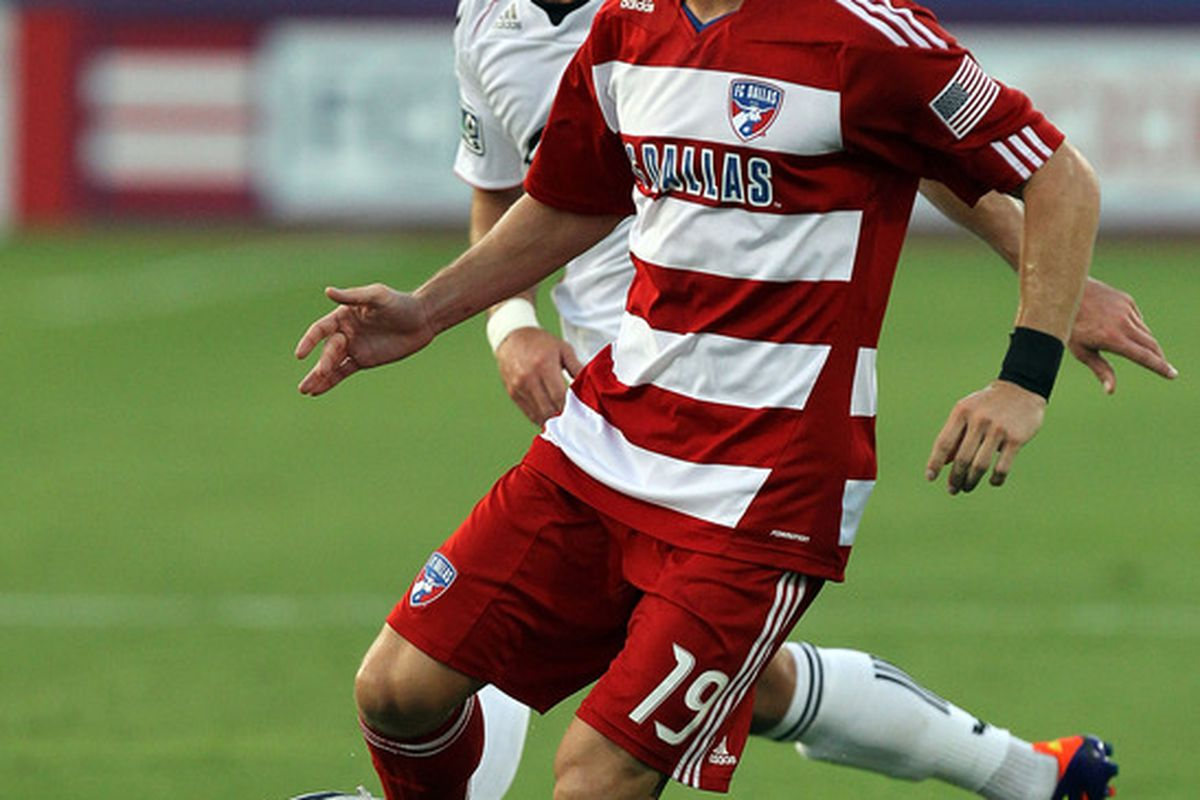 FRISCO, TX - JULY 16: Zach Loyd #19 of the FC Dallas dribbles the ball past Chris Pontius #13 of the D.C. United at Pizza Hut Park on July 16, 2011 in Frisco, Texas.  (Photo by Ronald Martinez/Getty Images)