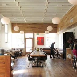 Long cypress wood communal tables, hanging orb lights and white ceiling rafters mark the interior. The new Piccino seats almost 100 people. <br />(c) Jennifer Yin / Eater SF
