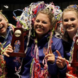 From left to right, Florida's Bridgey Caquatto, Morgan Frazier and Claire Boyce celebrate after being crowned co-champions with Oklahoma during the NCAA college women's gymnastics championships on Saturday, April 19, 2014, in Birmingham, Ala. (AP Photo/Butch Dill)