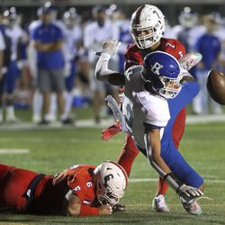 East's Sau Tafisi, left, breaks up a pass intended for Bingham's Isaiah Glasker during game at East High School in Salt Lake City on Friday, Sept. 25, 2020.
