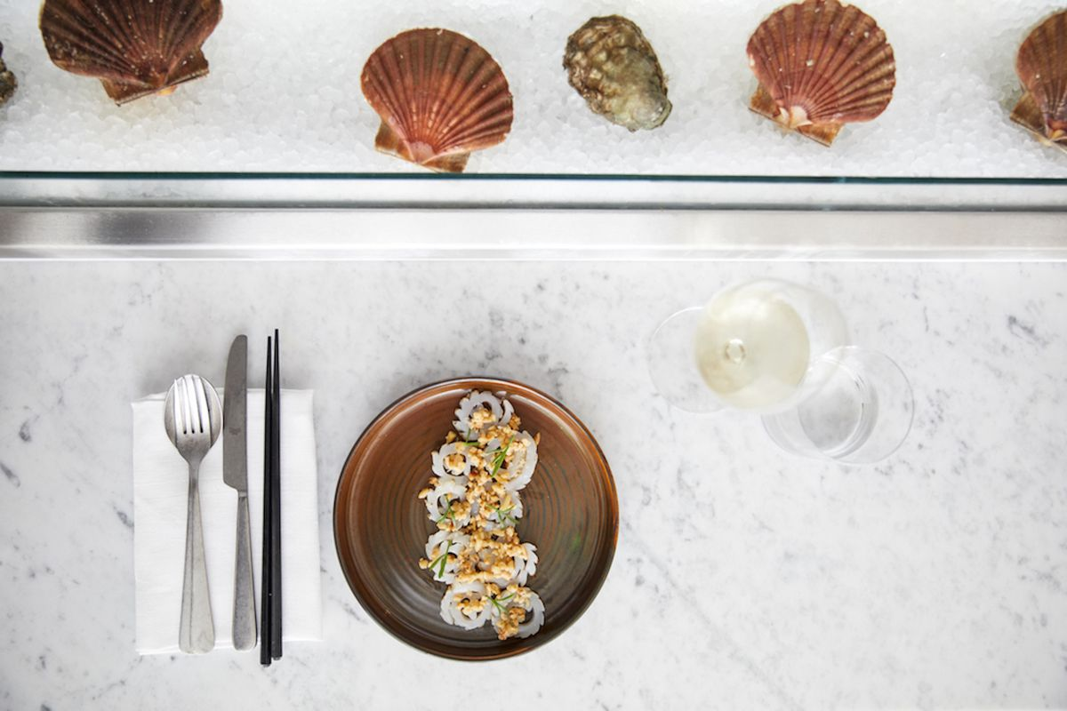 A fish dish with scallop shells and oysters on ice at London seafood restaurant The Sea The Sea