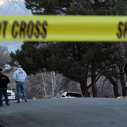 Law enforcement officers and crime scene investigators work at the scene of an overnight shooting at a home in Ogden Thursday, Jan. 5, 2012. Six officers, some from the Weber-Morgan Narcotics Strike Force were shot while serving a warrant at 3268 Jackson Ave.