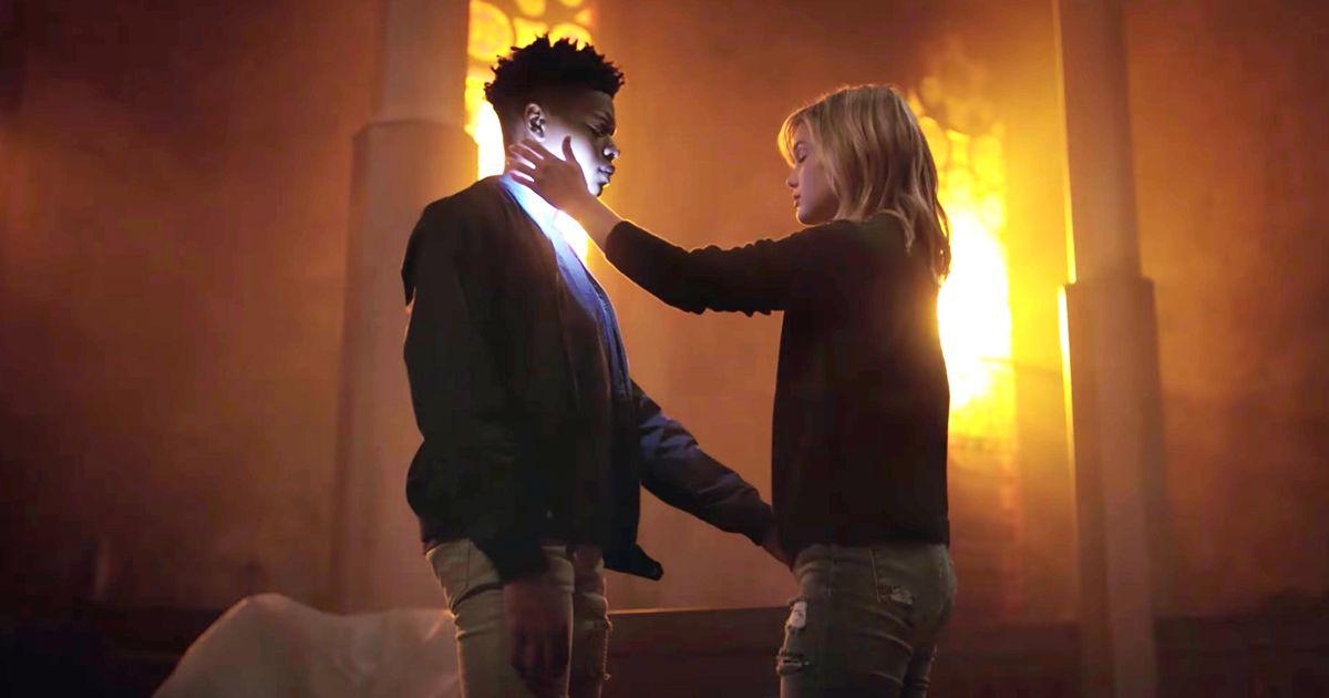 Dagger (Olivia Holt) holds her superpowered healing hand to Tyrone Johnson, aka Cloak (Aubrey Joseph)