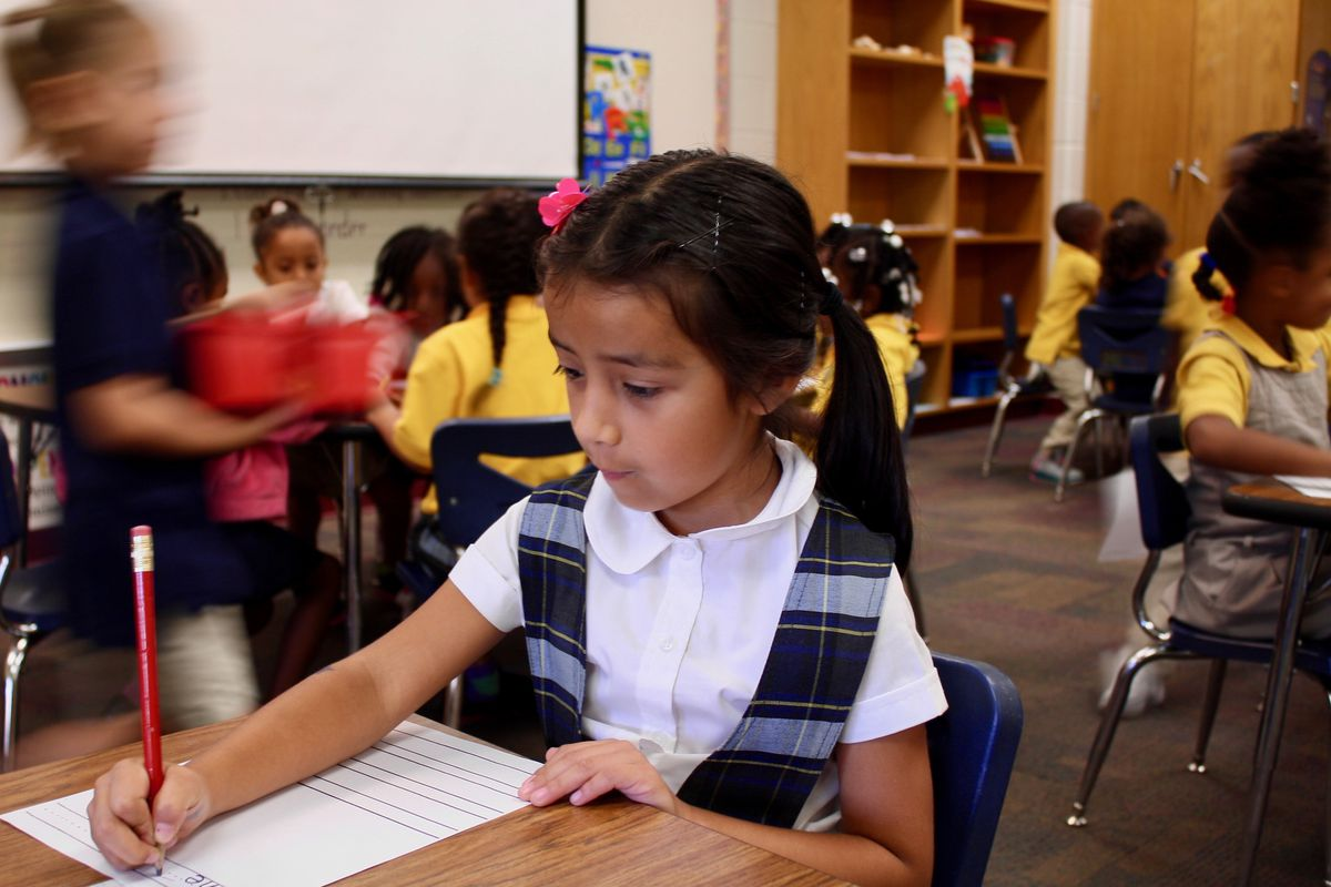 Zoe Roman, a kindergartener in Global Prep Academy's dual language program, fills in a writing worksheet.