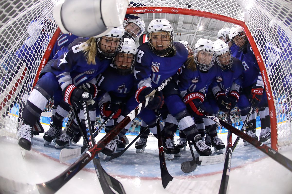GANGNEUNG, SOUTH KOREA - FEBRUARY 22: Team United States players pose in the goal prior to the Women's Gold Medal Game against Canada on day thirteen of the PyeongChang 2018 Winter Olympic Games at Gangneung Hockey Centre on February 22, 2018 in Gangneung