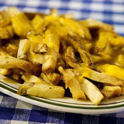 Disco Fries: somewhat related to cheese fries and poutine, disco fries are smothered with cheese and gravy. It's a cousin to the always popular chili fries.<br /><br />Found at: Bill's Bar & Burger, Jo's, Vynl, Thunder Jackson's<br /><br />Photo via <