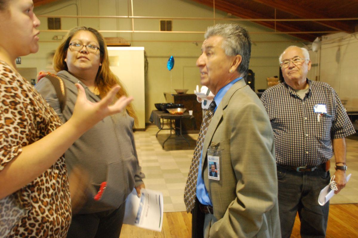 Javier Abrego, Adams 14 superintendent, center, speaks with parents after a forum in September 2016.